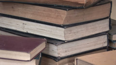 Pans the pile of old books 5 Stock Footage