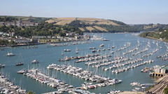 Stock Video Footage of View of Dartmouth Devon and boats on Dart river with railway track in foreground