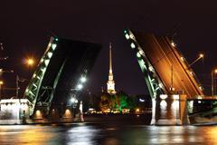 open drawbridge at night in st. petersburg - stock photo