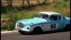 Retro cars racing: Studebaker Power Hawk and Mercedes 280S, click for HD Stock Footage