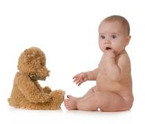 baby and teddy bear - stock photo
