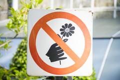 Do not pick the flowers sign Stock Photos