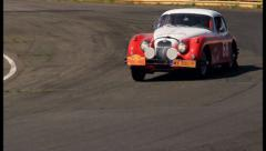 Jaguar XK150, vintage British sport car, bright colored. Racing, click for HD Stock Footage