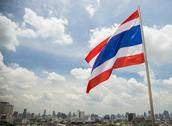 Stock Photo of thailand flag with city background