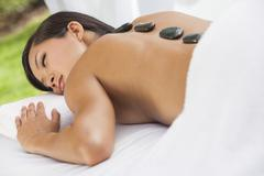 asian woman health spa hot stone treatment massage - stock photo