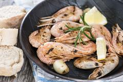 fried shrimps in a skillet - stock photo