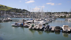 Boats and yachts in Dartmouth harbour Devon on the River Dart Kingswear side - stock footage