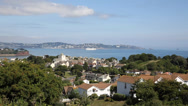Stock Video Footage of View of Torquay coast and bay Devon England from Paignton