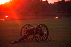 High Res - Civil War Canon Sunset at Lake - stock photo