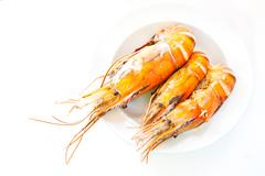 Stock Photo of grilled prawns on white plate isolated