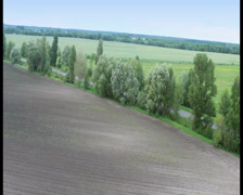 Aerial countryside view, landscape ヨ trees, road, blue horizon, click for HD - stock footage