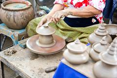thailand craftsman working on pottery clay and crafts - stock photo