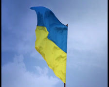 Ukrainian national flag waving on flagpole in blue sky. Ukraine, click for HD Stock Footage
