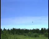 Stock Video Footage of Hot air balloon landing in blue sky time-lapse, click for HD