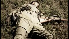 Second world war reconstruction, body of dead soldier on earth., click for HD Stock Footage