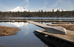 Cascade mountain range rises above alpine lake oregon state Stock Photos
