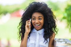 Outdoor portrait of a teenage black girl using a mobile phone - african peopl Stock Photos