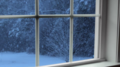 Winter snow storm at dusk seen through window Stock Footage