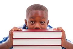 Stock Photo of african american school boy with stack a book - black people