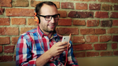 Young man listen to the music on smartphone HD Stock Footage