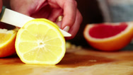 Woman hands slicing lemon HD Stock Footage