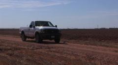 Farmer in pickup inspects fields Stock Footage