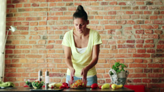 Woman mixing, preparing salad in kitchen HD Stock Footage