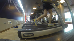 People at the gym exercising on a cross trainer Treadmill jogging fitness sport Stock Footage