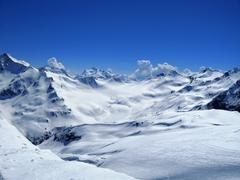 Caucasus mountains under the snow and clear sky Stock Photos