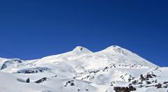 Stock Photo of caucasus mountains under the snow and clear sky