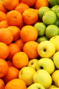 Oranges and apples Stock Photos