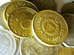 old coins from different countries and different times - stock photo