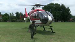 HELICOPTER GROUND STAFF PREPARE TAKE OFF Stock Footage