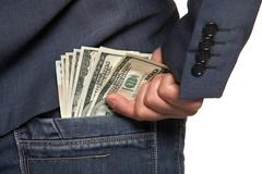 Male hand draws out a money from the pocket of jeans, close-up Stock Photos
