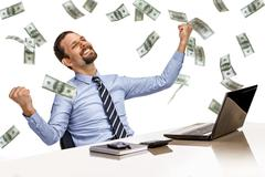 Young modern businessman excited with his success  with money rain - stock photo