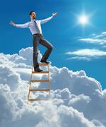 Successful businessman with open arms standing at the top of ladder - stock illustration