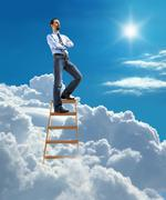 Confident businessman standing at the top of ladder high in the sky - stock illustration