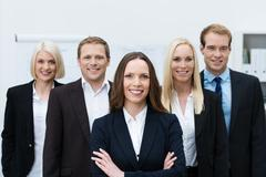 successful self-assured business team - stock photo