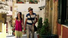 Tourist couple sightseeing old town HD - stock footage
