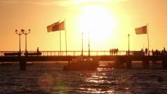 Silhouettes of people and speed boat arrival on pier in France Stock Footage