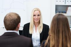 Businesswoman being interviewed for a post Stock Photos