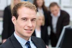 Thoughtful handsome business executive Stock Photos