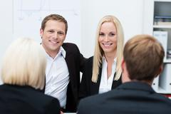 Smiling coworkers in a business meeting Stock Photos
