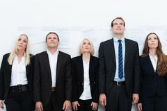 Professional team looking up Stock Photos