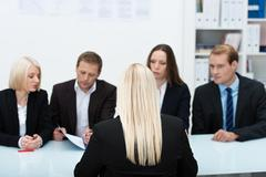 human resources team conducting an interview - stock photo