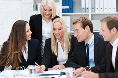 dedicated business team having a discussion - stock photo