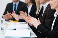 Stock Photo of businesspeople in a meeting applauding