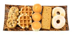 Cakes, cookies, donuts and waffles on the plate Stock Photos