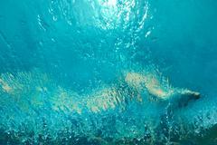 Abstract human body in water splashing Stock Photos