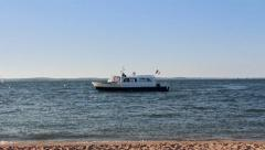 French flag boat maneuvering in Arcachon bay - Full HD Stock Footage
